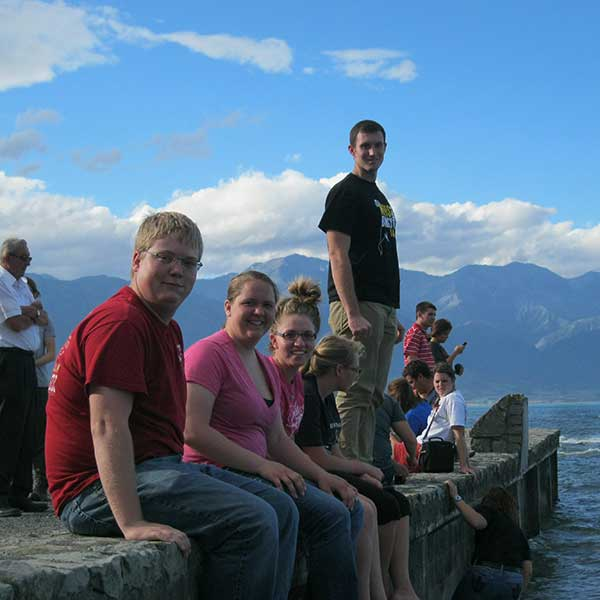 Photo of Engler students on the sea wall in New Zealand