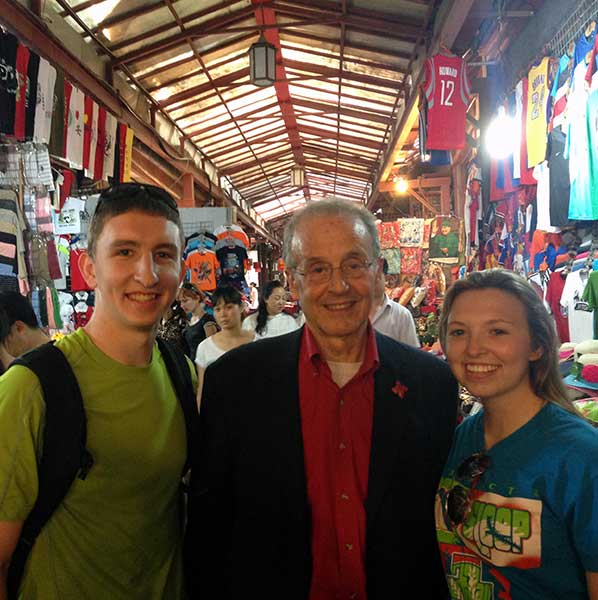 Cody Kuester with Harvey Perlman and another UNL student in China